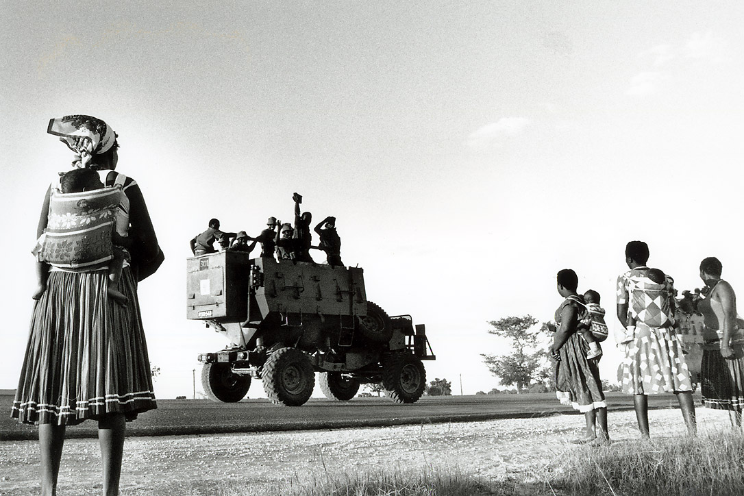 Oshiwambo mothers watch South African soldiers driving towards Ondangwa, northern Namibia.