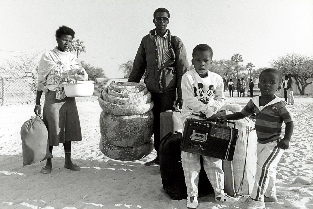 Returnees leave the Ongwediva reception centre for their homes in northern Namibia carrying household possessions.