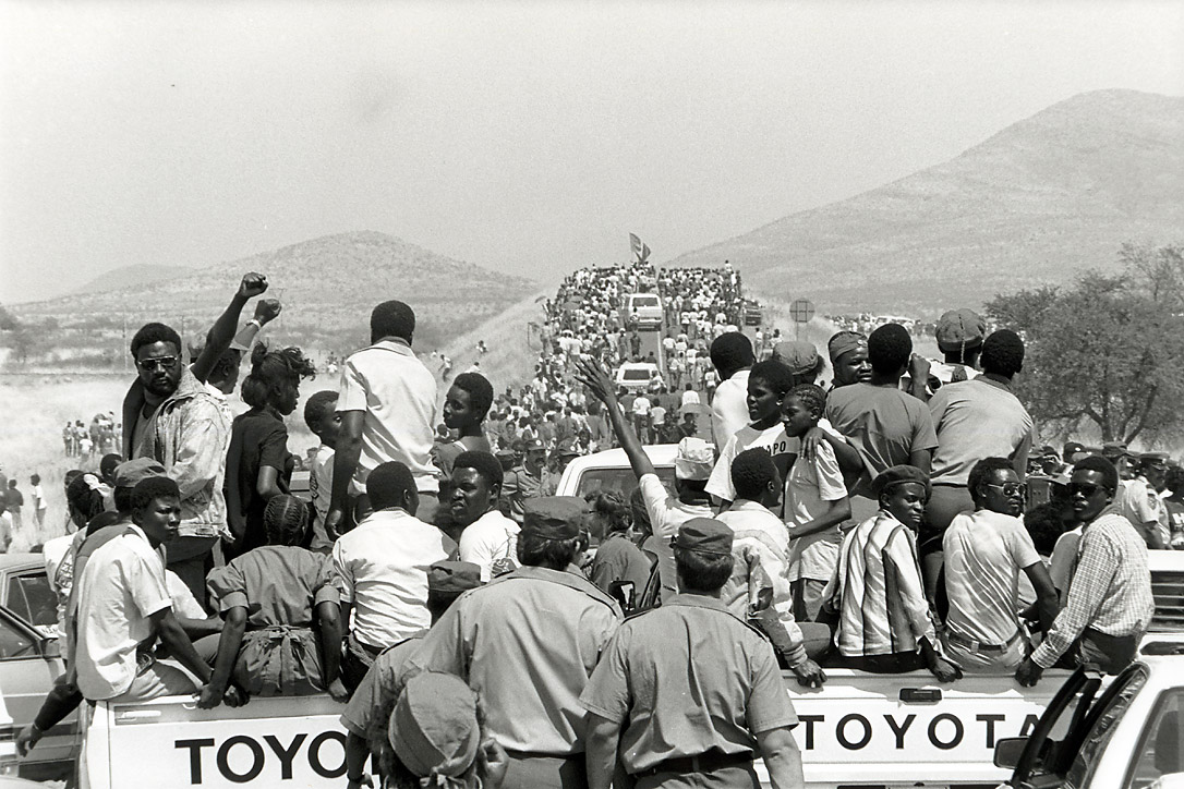 Over 10,000 Namibians make their way to Windhoek airport to welcome the SWAPO (South West Africa People's Organisation) leader, Sam Nujoma, after 30 years of exile, on 14 September 1989.