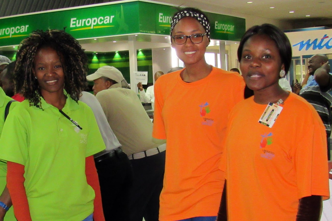Julia Nekongo (right) volunteering at the Hosea Kutako International Airport in Namibia with her friends. Photo: LWF/Umesh Pokharel