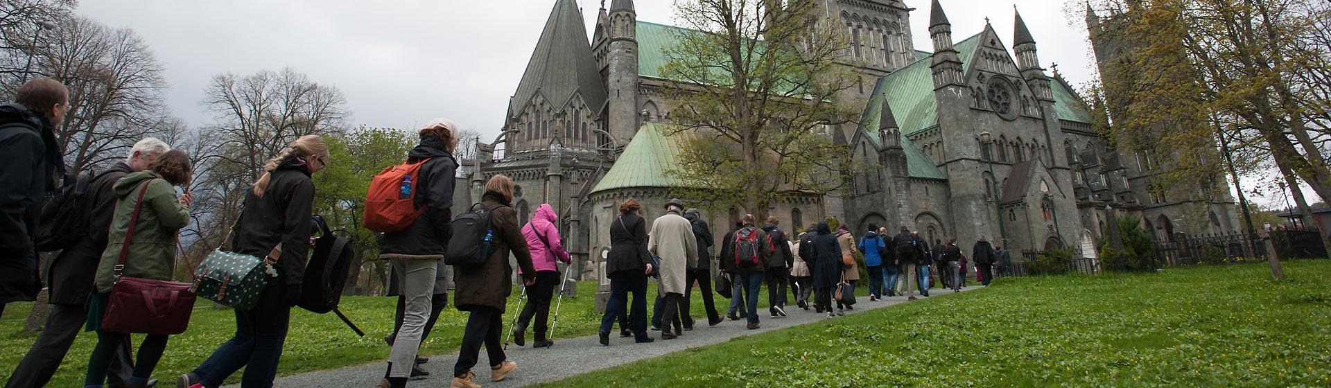 Attendees of 2015 consultation in Trondheim, Norway, make their way toward a church