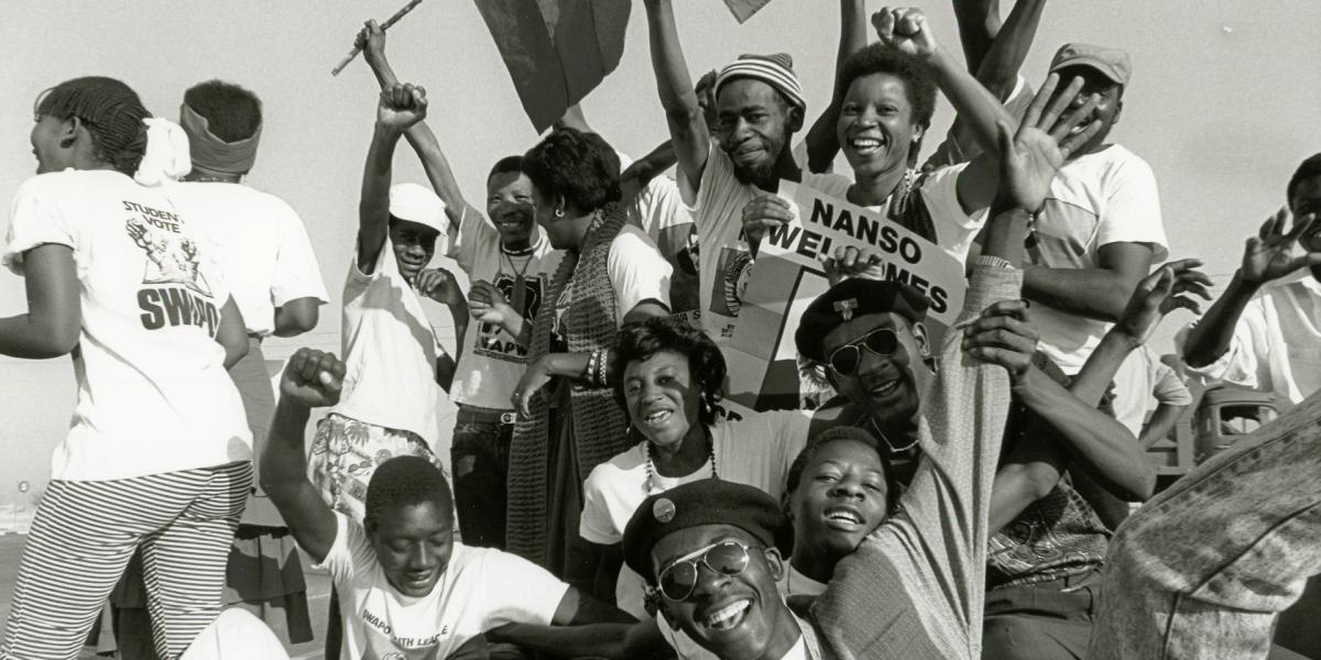 Students celebrate the return of exiled SWAPO leader Sam Nujoma on 14 September 1989