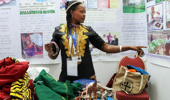 Griftiel Abraham Mshana, a Youth Leader at the Evangelical Lutheran Church in Tanzania presenting traditional crafts. Photo: LWF/Brenda Platero