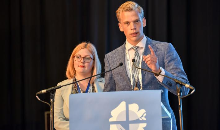 Sem Loggen presents the Youth message to the participants of the Twelfth LWF Assembly. Photo: LWF/Albin Hillert